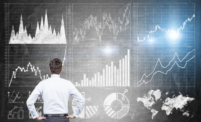 54962306 - research concept with businessman looking at forex charts on dark grey concrete wall
